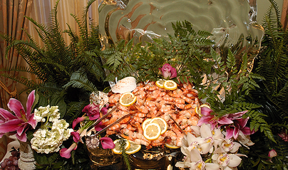 Cocktail shrimp and ice sculpture for catered wedding