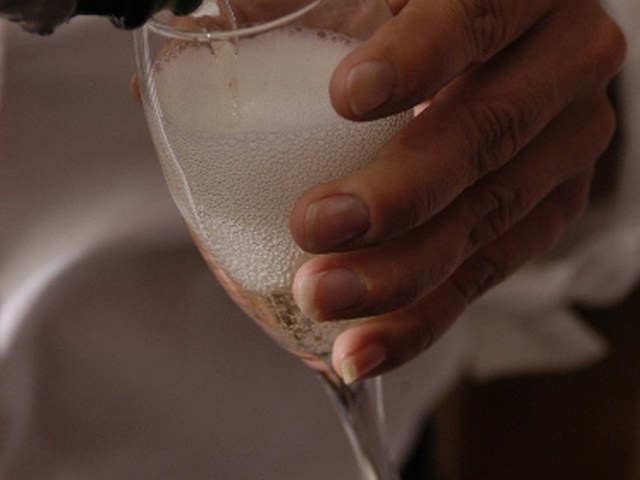 Catering server pours champagne for St. Pete FL Bar Catering Event